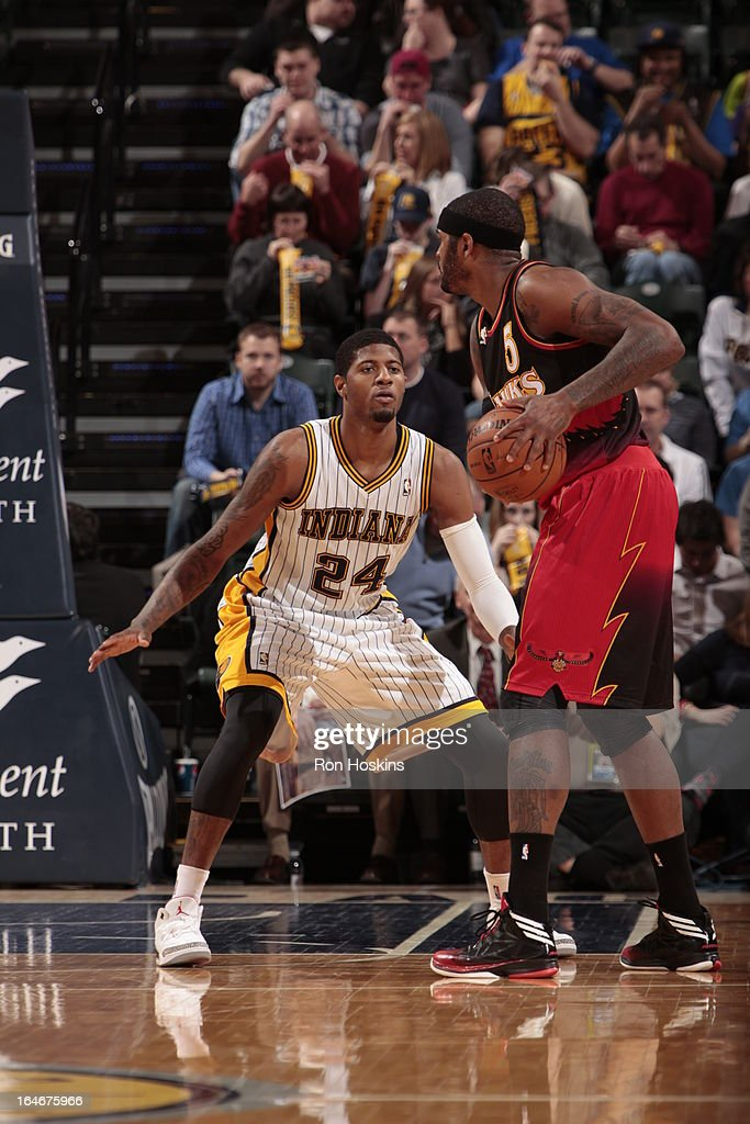 Paul George #24 of the Indiana Pacers defends against <a gi-track='captionPersonalityLinkClicked' href=/galleries/search?phrase=Josh+Smith+-+Basketball+Player+-+Born+1985&family=editorial&specificpeople=201983 ng-click='$event.stopPropagation()'>Josh Smith</a> #5 of the Atlanta Hawks on March 25, 2013 at Bankers Life Fieldhouse in Indianapolis, Indiana.