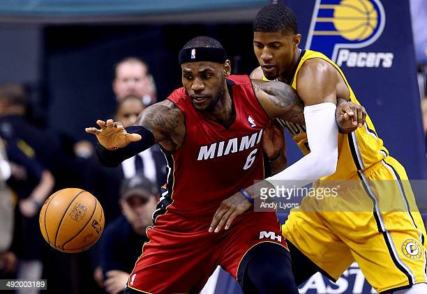 Paul George of the Indiana Pacers defends against LeBron James of the Miami Heat during Game One of the Eastern Conference Finals of the 2014 NBA...