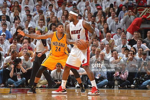Paul George of the Indiana Pacers defends LeBron James of the Miami Heat in Game Seven of the Eastern Conference Finals during the 2013 NBA Playoffs...