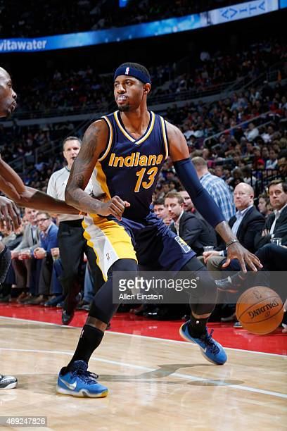 Paul George of the Indiana Pacers defends the ball against the Detroit Pistons during the game on April 10 2015 at The Palace of Auburn in Detroit...