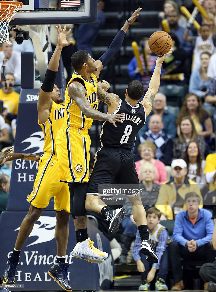 Paul George #24 of the Indiana Pacers defends the shot of <a gi-track='captionPersonalityLinkClicked' href=/galleries/search?phrase=Deron+Williams&family=editorial&specificpeople=203215 ng-click='$event.stopPropagation()'>Deron Williams</a> #8 of the Brooklyn Nets at Bankers Life Fieldhouse on April 12, 2013 in Indianapolis, Indiana.