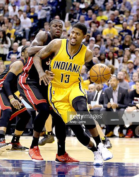 Paul George of the Indiana Pacers dribbles the ball against the Miami Heat at Bankers Life Fieldhouse on April 5 2015 in Indianapolis Indiana Tonight...
