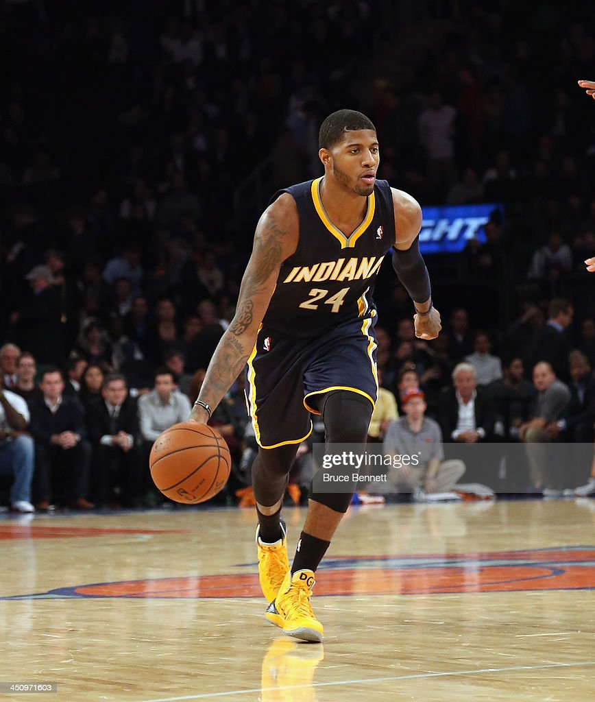 Paul George #24 of the Indiana Pacers dribbles the ball against the New York Knicks at Madison Square Garden on November 20, 2013 in New York City.