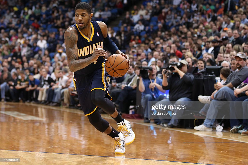Paul George #24 of the Indiana Pacers dribbles the ball against the Minnesota Timberwolves on February 19, 2014 at Target Center in Minneapolis, Minnesota.