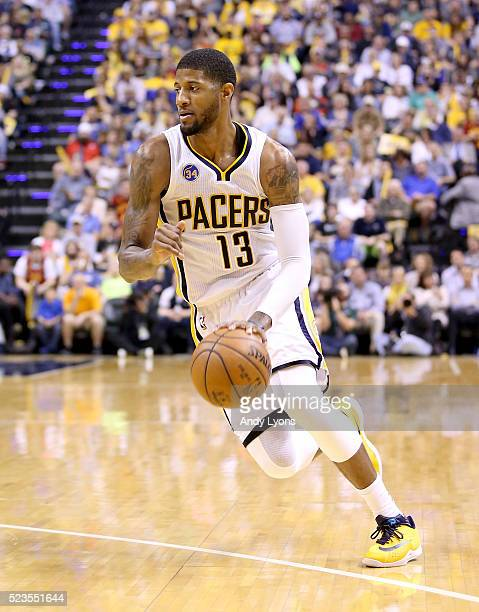 Paul George of the Indiana Pacers dribbles the ball against the Toronto Raptors during game four of the 2016 NBA Eastern Conference Quarterfinal...