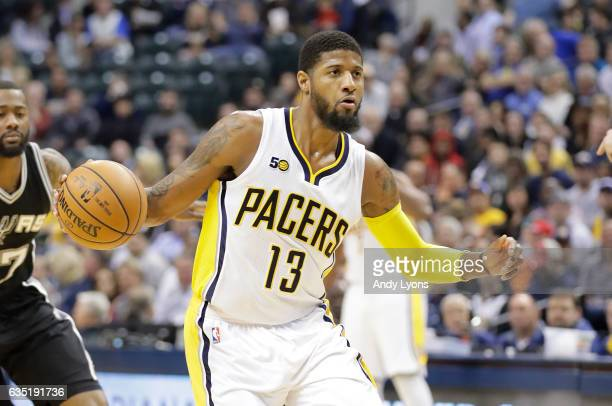 Paul George of the Indiana Pacers dribbles the ball against the San Antonio Spurs at Bankers Life Fieldhouse on February 13 2017 in Indianapolis...
