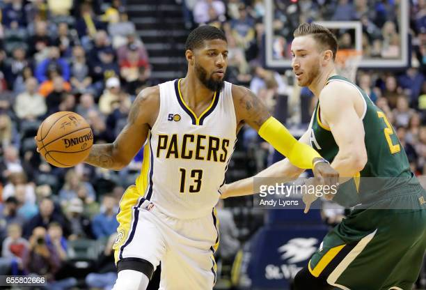 Paul George of the Indiana Pacers dribbles the ball against the Utah Jazz at Bankers Life Fieldhouse on March 20 2017 in Indianapolis Indiana NOTE TO...