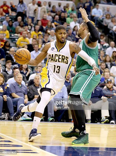 Paul George of the Indiana Pacers dribbles the ball during the game against the Boston Celtics at Bankers Life Fieldhouse on November 4 2015 in...
