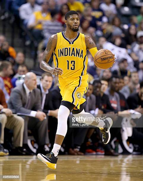 Paul George of the Indiana Pacers dribbles the ball during the game against the Chicago Bulls at Bankers Life Fieldhouse on November 27 2015 in...