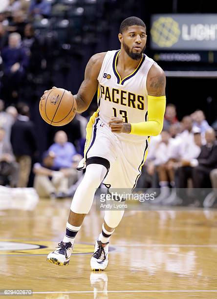 Paul George of the Indiana Pacers dribbles the ball during the game against the Charlotte Hornets at Bankers Life Fieldhouse on December 12 2016 in...