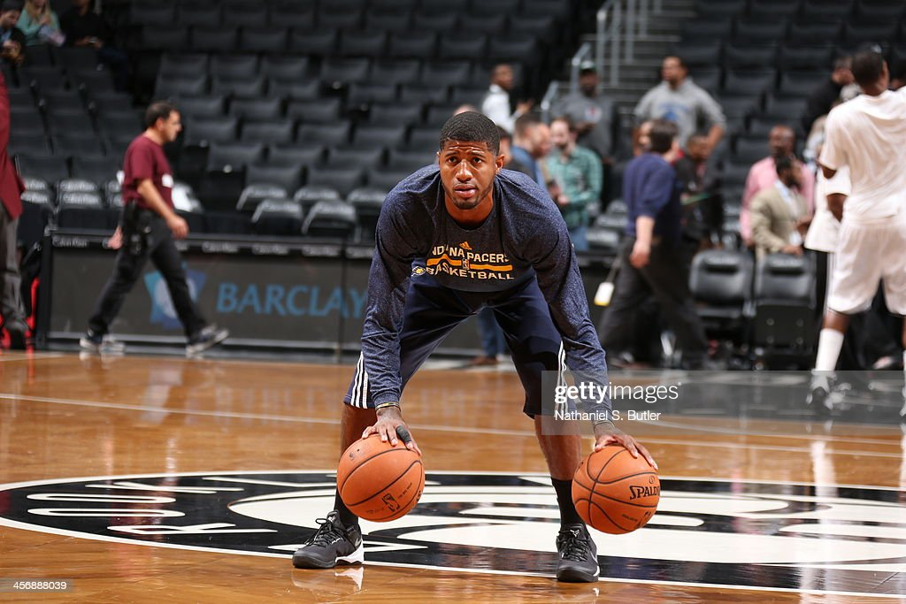 Paul George #24 of the Indiana Pacers dribbles the ball in during pre-game warm-ups before playing against the game warms up before playing against the Brooklyn Nets during a game at Barclays Center on November 9, 2013 in the Brooklyn borough of New York City.