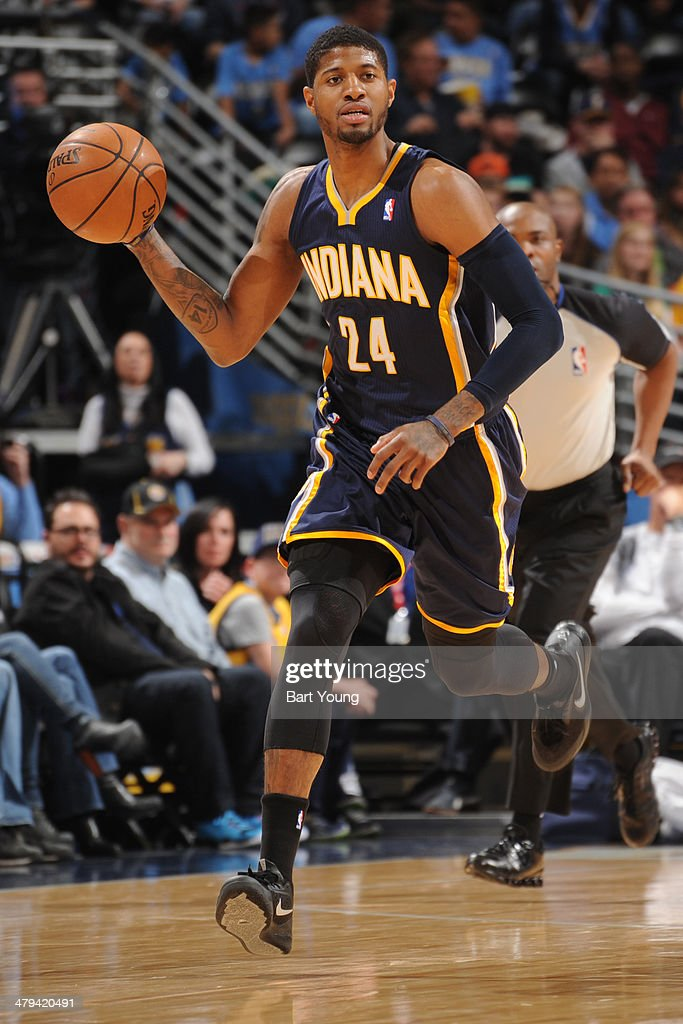 Paul George #24 of the Indiana Pacers dribbles the ball versus the Denver Nuggets on January 25, 2014 at the Pepsi Center in Denver, Colorado.