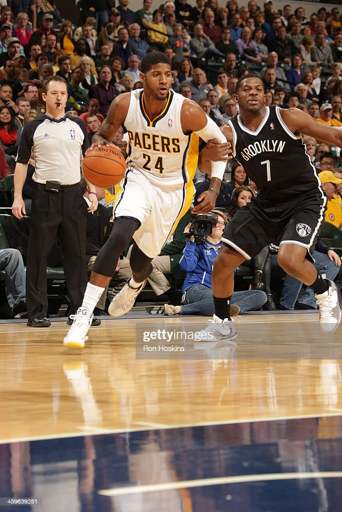 Paul George #24 of the Indiana Pacers dribbles to the basket against the Brooklyn Nets at Bankers Life Fieldhouse on December 28, 2013 in Indianapolis, Indiana.