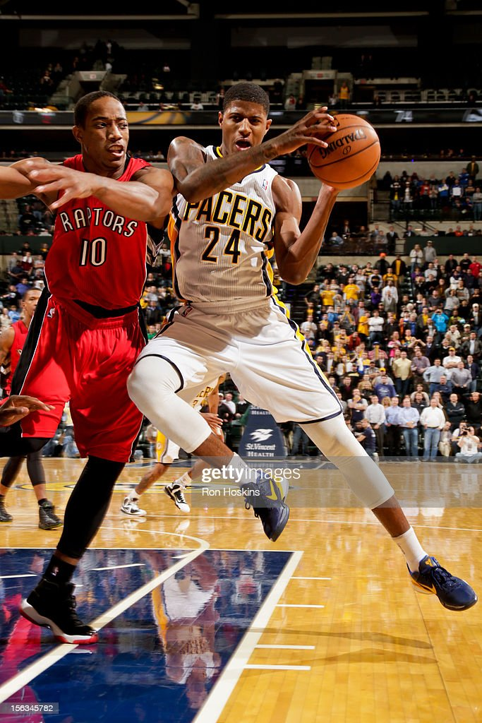 Paul George #24 of the Indiana Pacers drives against DeMar DeRozan #10 of the Toronto Raptors on November 13, 2012 at Bankers Life Fieldhouse in Indianapolis, Indiana.