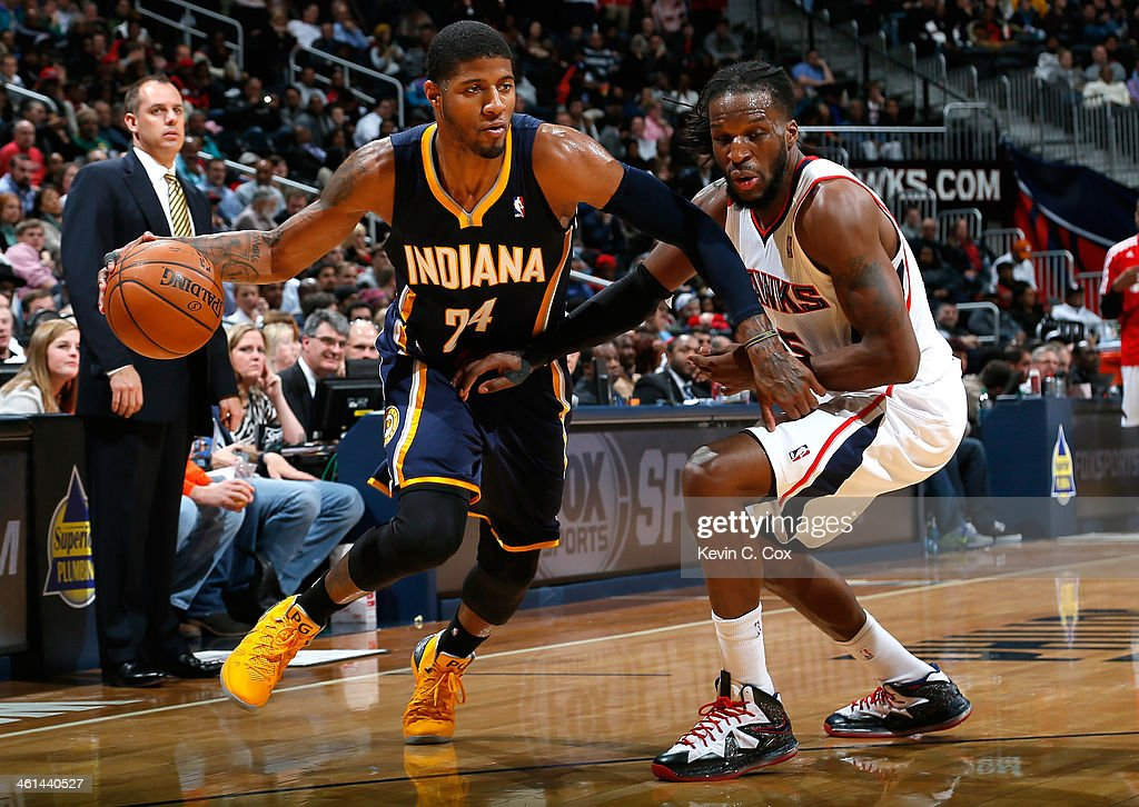 Paul George #24 of the Indiana Pacers drives against DeMarre Carroll #5 of the Atlanta Hawks at Philips Arena on January 8, 2014 in Atlanta, Georgia.