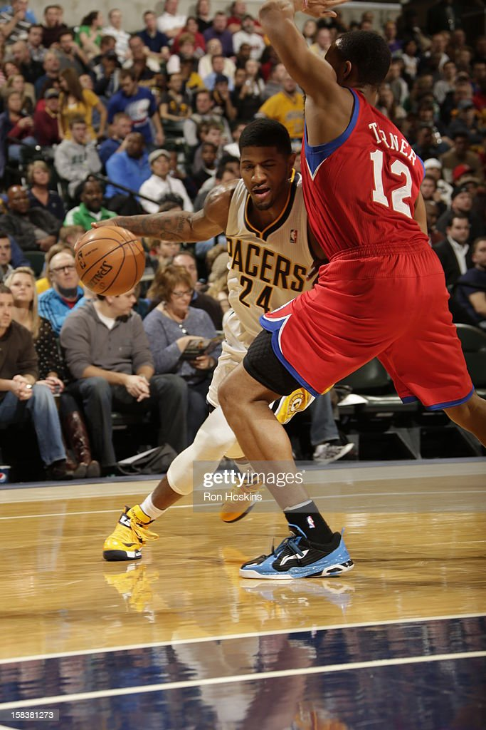 Paul George #24 of the Indiana Pacers drives against <a gi-track='captionPersonalityLinkClicked' href=/galleries/search?phrase=Evan+Turner&family=editorial&specificpeople=4665764 ng-click='$event.stopPropagation()'>Evan Turner</a> #12 of the Philadelphia 76ers on December 14, 2012 at Bankers Life Fieldhouse in Indianapolis, Indiana.