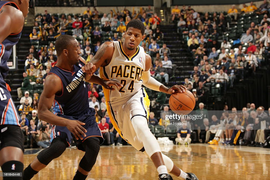 Paul George #24 of the Indiana Pacers drives against Kemba Walker #15 of the Charlotte Bobcats on February 13, 2013 at Bankers Life Fieldhouse in Indianapolis, Indiana.