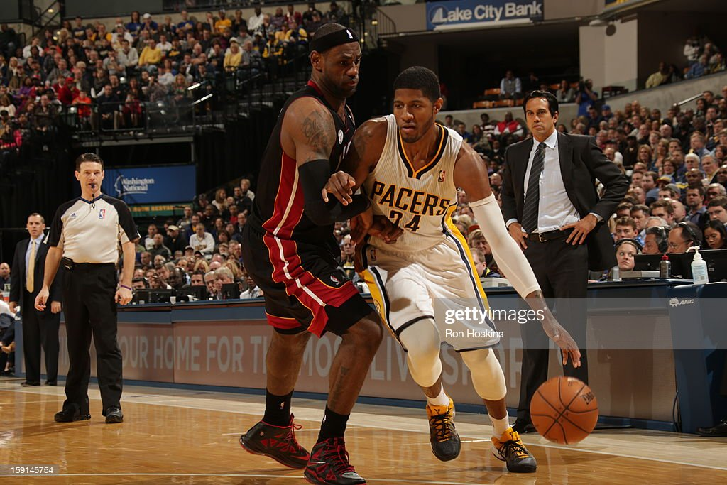 Paul George #24 of the Indiana Pacers drives against <a gi-track='captionPersonalityLinkClicked' href=/galleries/search?phrase=LeBron+James&family=editorial&specificpeople=201474 ng-click='$event.stopPropagation()'>LeBron James</a> #6 of the Miami Heat on January 8, 2013 at Bankers Life Fieldhouse in Indianapolis, Indiana.