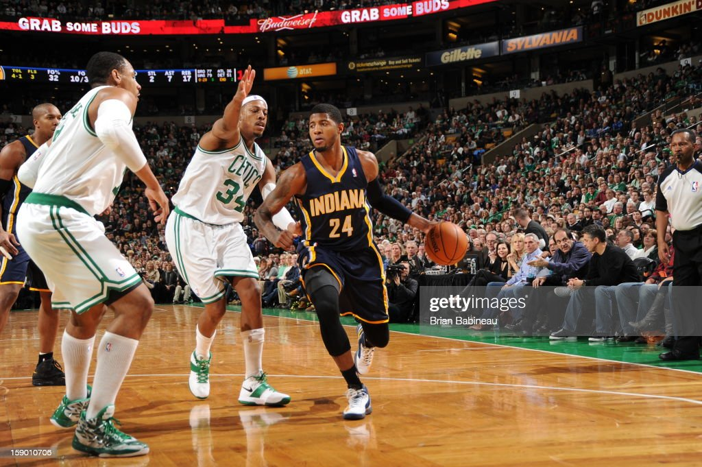 Paul George #24 of the Indiana Pacers drives against Paul Pierce #34 and Jared Sullinger #7 of the Boston Celtics on January 4, 2013 at the TD Garden in Boston, Massachusetts.
