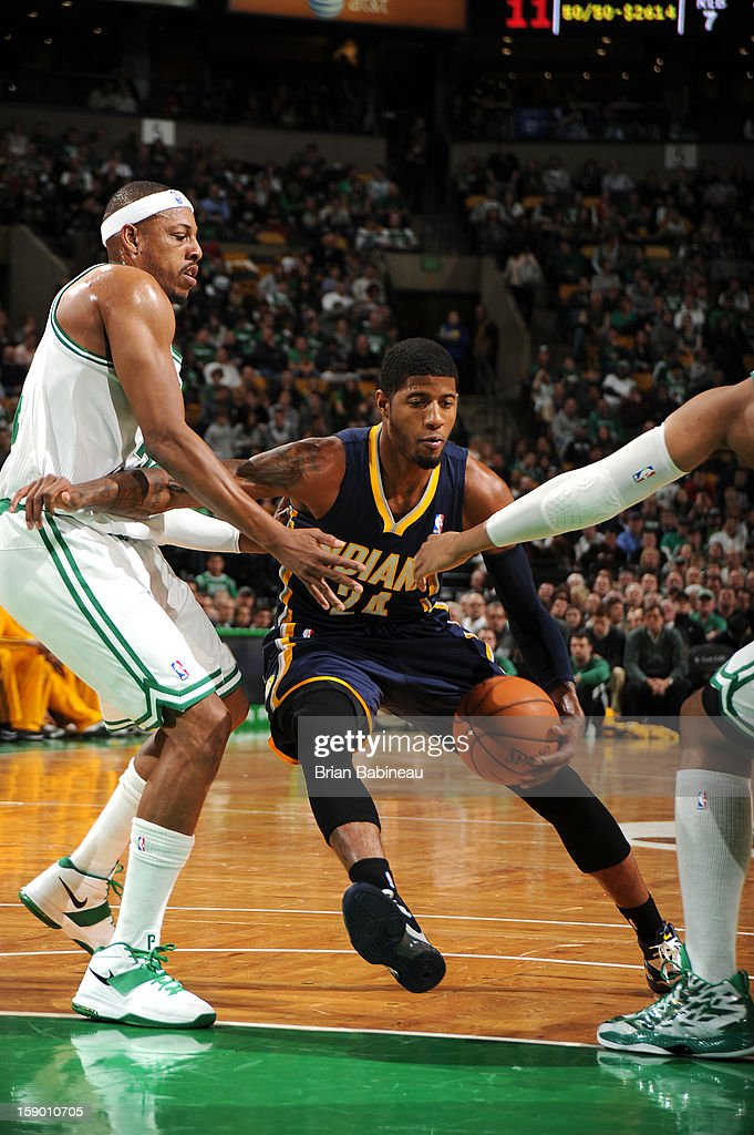 Paul George #24 of the Indiana Pacers drives against <a gi-track='captionPersonalityLinkClicked' href=/galleries/search?phrase=Paul+Pierce&family=editorial&specificpeople=201562 ng-click='$event.stopPropagation()'>Paul Pierce</a> #34 of the Boston Celtics on January 4, 2013 at the TD Garden in Boston, Massachusetts.