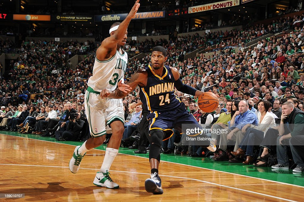 Paul George #24 of the Indiana Pacers drives against Paul Pierce #34 of the Boston Celtics on January 4, 2013 at the TD Garden in Boston, Massachusetts.