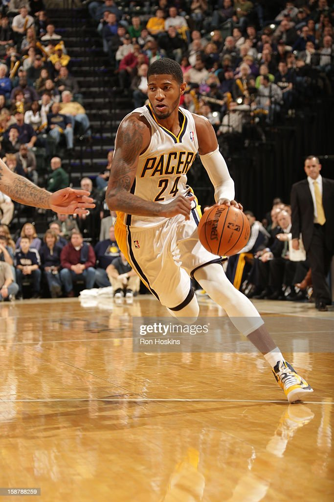 Paul George #24 of the Indiana Pacers drives against the Phoenix Suns on December 28, 2012 at Bankers Life Fieldhouse in Indianapolis, Indiana.