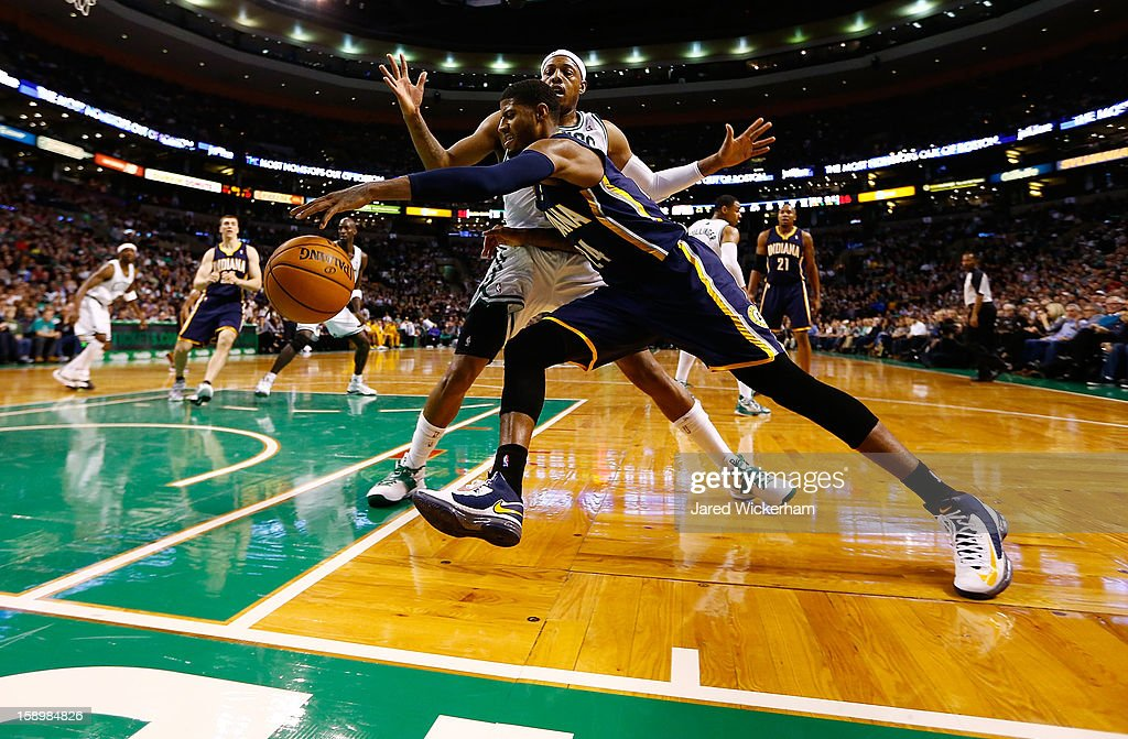 Paul George #24 of the Indiana Pacers drives baseline against Paul Pierce #34 of the Boston Celtics during the game on January 4, 2013 at TD Garden in Boston, Massachusetts.