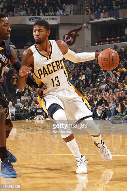 Paul George of the Indiana Pacers drives to the basket against Jeff Green of the Memphis Grizzlies during the game on October 29 2015 at Bankers Life...
