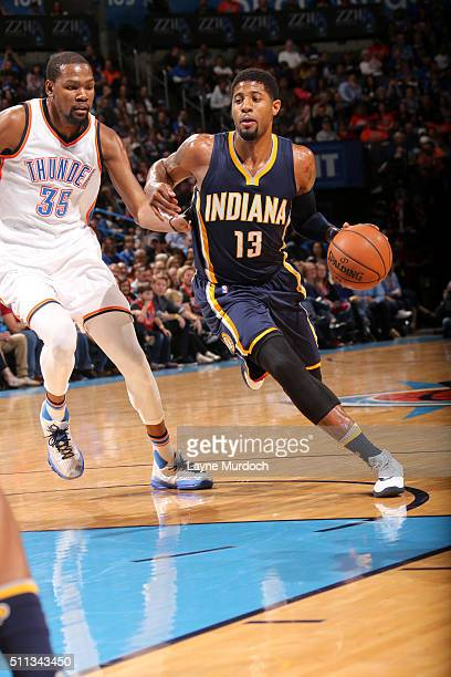 Paul George of the Indiana Pacers drives to the basket against Kevin Durant of the Oklahoma City Thunder on February 19 2016 at Chesapeake Energy...