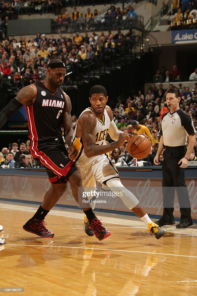 Paul George #24 of the Indiana Pacers drives to the basket against <a gi-track='captionPersonalityLinkClicked' href=/galleries/search?phrase=LeBron+James&family=editorial&specificpeople=201474 ng-click='$event.stopPropagation()'>LeBron James</a> #6 of the Miami Heat on January 8, 2013 at Bankers Life Fieldhouse in Indianapolis, Indiana.