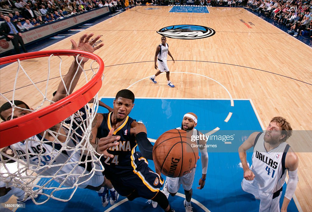 Paul George #24 of the Indiana Pacers drives to the basket against the Dallas Mavericks on March 28, 2013 at the American Airlines Center in Dallas, Texas.