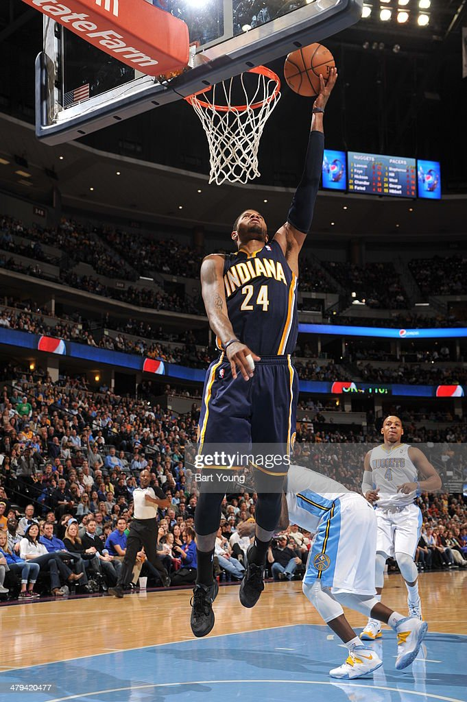 Paul George #24 of the Indiana Pacers drives to the basket against the Denver Nuggets on January 25, 2014 at the Pepsi Center in Denver, Colorado.