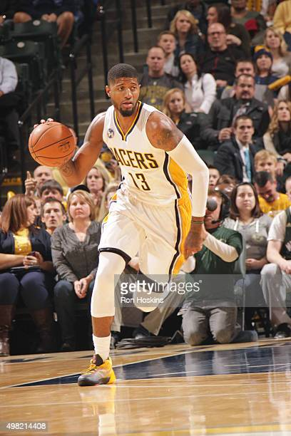 Paul George of the Indiana Pacers drives to the basket against the Milwaukee Bucks during the game on November 21 2015 at Bankers Life Fieldhouse in...