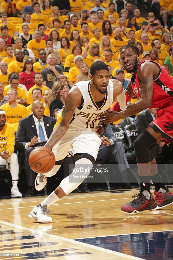 <a gi-track='captionPersonalityLinkClicked' href=/galleries/search?phrase=Paul+George+-+Basketball+Player&family=editorial&specificpeople=7235030 ng-click='$event.stopPropagation()'>Paul George</a> #13 of the Indiana Pacers drives to the basket against the Toronto Raptors in Game Six of the Eastern Conference Quarterfinals during the 2016 NBA Playoffs on April 29, 2016 at Bankers Life Fieldhouse in Indianapolis, Indiana.