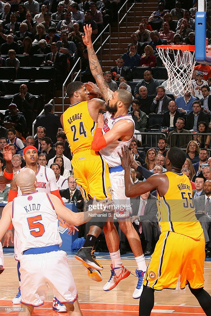 Paul George #24 of the Indiana Pacers drives to the basket against Tyson Chandler #6 of the New York Knicks in Game Two of the Eastern Conference Semifinals during the 2013 NBA Playoffs on May 7, 2013 at Madison Square Garden in New York City.