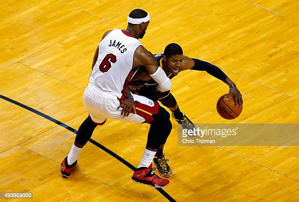 Paul George of the Indiana Pacers drives to the basket as LeBron James of the Miami Heat defends during Game Four of the Eastern Conference Finals of...