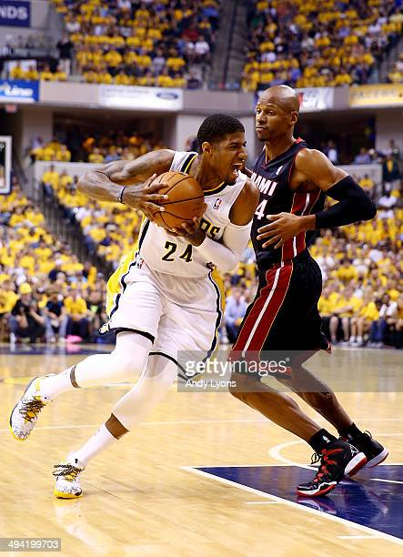Paul George of the Indiana Pacers drives to the basket as Ray Allen of the Miami Heat defends during Game Five of the Eastern Conference Finals of...