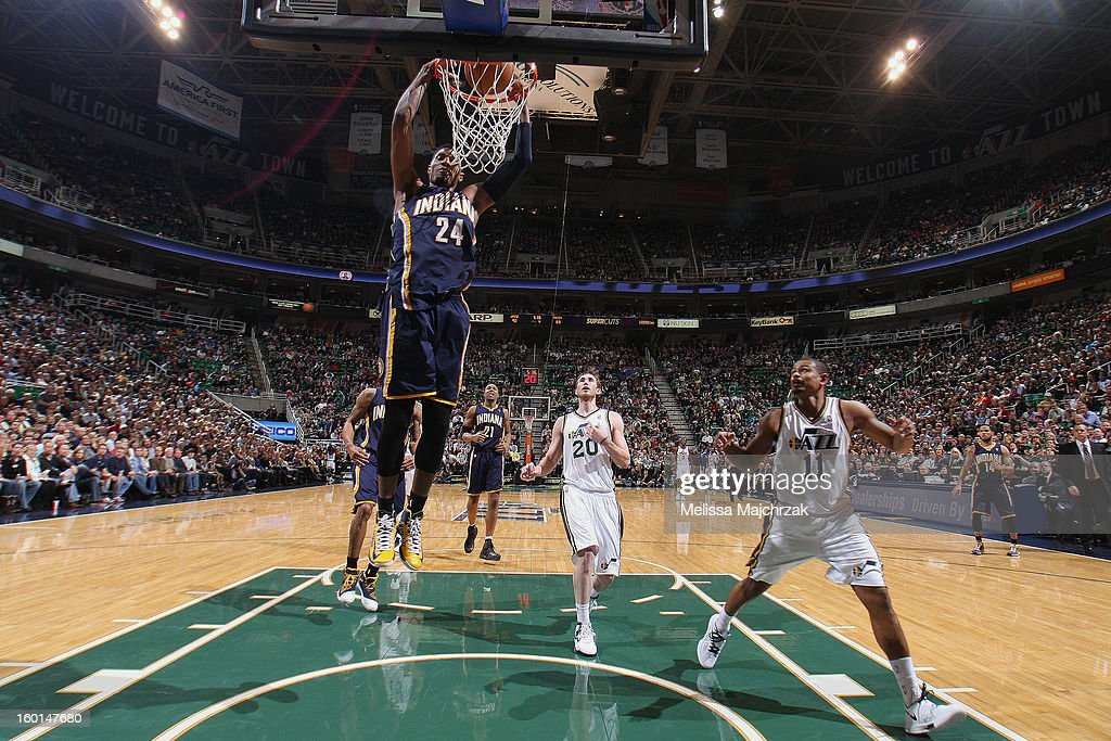 Paul George #24 of the Indiana Pacers dunks against <a gi-track='captionPersonalityLinkClicked' href=/galleries/search?phrase=Gordon+Hayward&family=editorial&specificpeople=5767271 ng-click='$event.stopPropagation()'>Gordon Hayward</a> #20 and <a gi-track='captionPersonalityLinkClicked' href=/galleries/search?phrase=Earl+Watson&family=editorial&specificpeople=201841 ng-click='$event.stopPropagation()'>Earl Watson</a> #11 of the Utah Jazz at Energy Solutions Arena on January 26, 2013 in Salt Lake City, Utah.