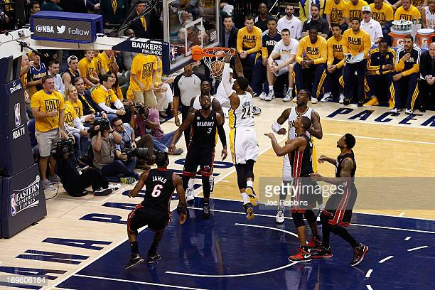 Paul George of the Indiana Pacers dunks against LeBron James and Dwyane Wade of the Miami Heat during Game Four of the Eastern Conference Finals of...