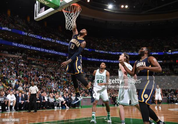 Paul George of the Indiana Pacers dunks against the Boston Celtics during the game on March 22 2017 at the TD Garden in Boston Massachusetts NOTE TO...