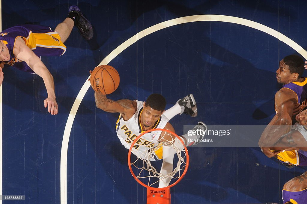 Paul George #24 of the Indiana Pacers dunks against the Los Angeles Lakers on March 15, 2013 at Bankers Life Fieldhouse in Indianapolis, Indiana.