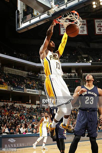 Paul George of the Indiana Pacers dunks against the New Orleans Pelicans during a preseason game on October 3 2015 at Bankers Life Fieldhouse in...