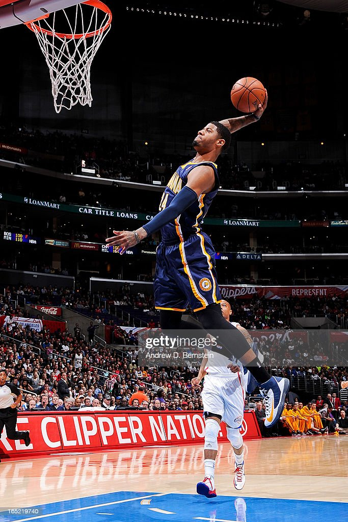 Paul George #24 of the Indiana Pacers dunks on a fast break against the Los Angeles Clippers at Staples Center on April 1, 2013 in Los Angeles, California.