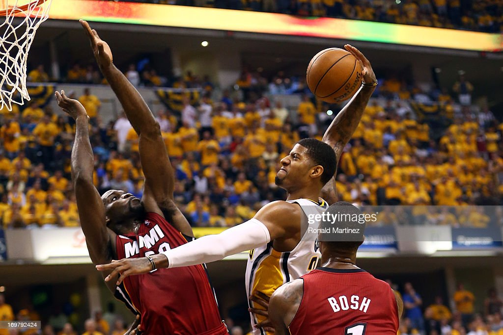 Paul George #24 of the Indiana Pacers dunks the ball against <a gi-track='captionPersonalityLinkClicked' href=/galleries/search?phrase=Joel+Anthony&family=editorial&specificpeople=4092295 ng-click='$event.stopPropagation()'>Joel Anthony</a> #50 and <a gi-track='captionPersonalityLinkClicked' href=/galleries/search?phrase=Chris+Bosh&family=editorial&specificpeople=201574 ng-click='$event.stopPropagation()'>Chris Bosh</a> #1 of the Miami Heat in Game Six of the Eastern Conference Finals during the 2013 NBA Playoffs at Bankers Life Fieldhouse on June 1, 2013 in Indianapolis, Indiana.
