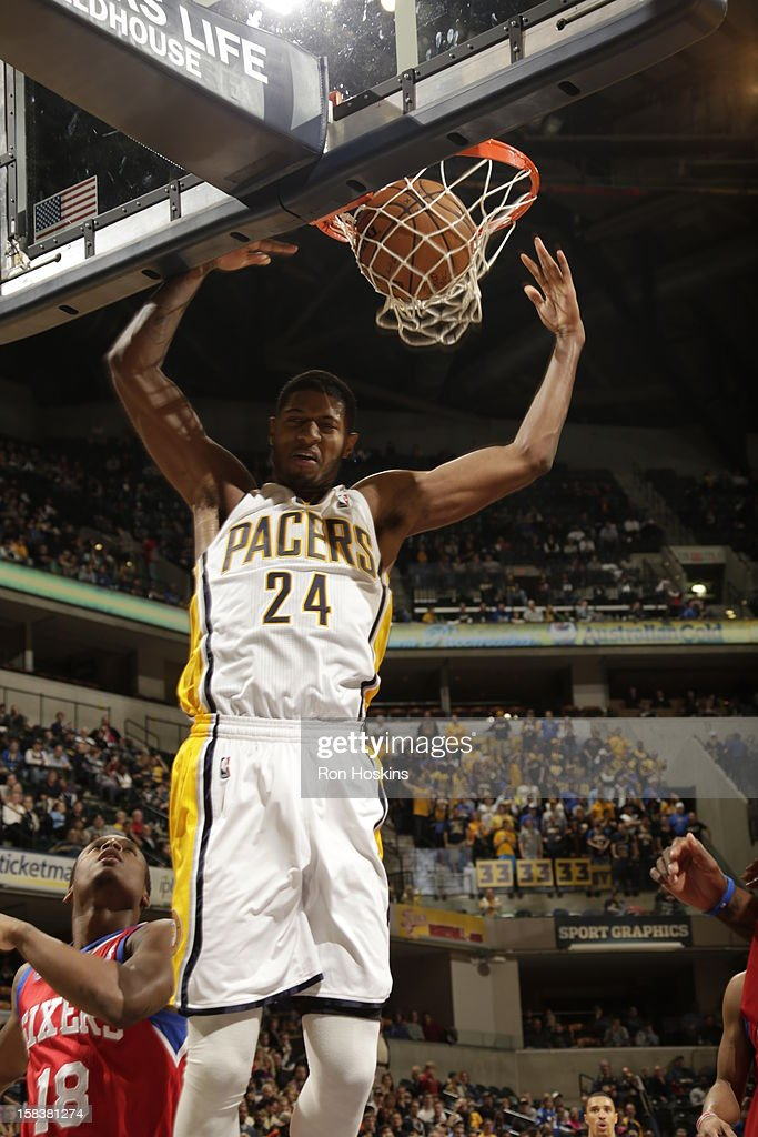 Paul George #24 of the Indiana Pacers dunks the ball against <a gi-track='captionPersonalityLinkClicked' href=/galleries/search?phrase=Maalik+Wayns&family=editorial&specificpeople=5792005 ng-click='$event.stopPropagation()'>Maalik Wayns</a> #18 of the Philadelphia 76ers on December 14, 2012 at Bankers Life Fieldhouse in Indianapolis, Indiana.