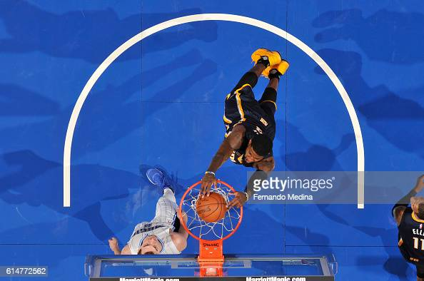 Paul George of the Indiana Pacers dunks the ball during a preseason game against the Orlando Magic on October 14 2016 at Amway Center in Orlando...