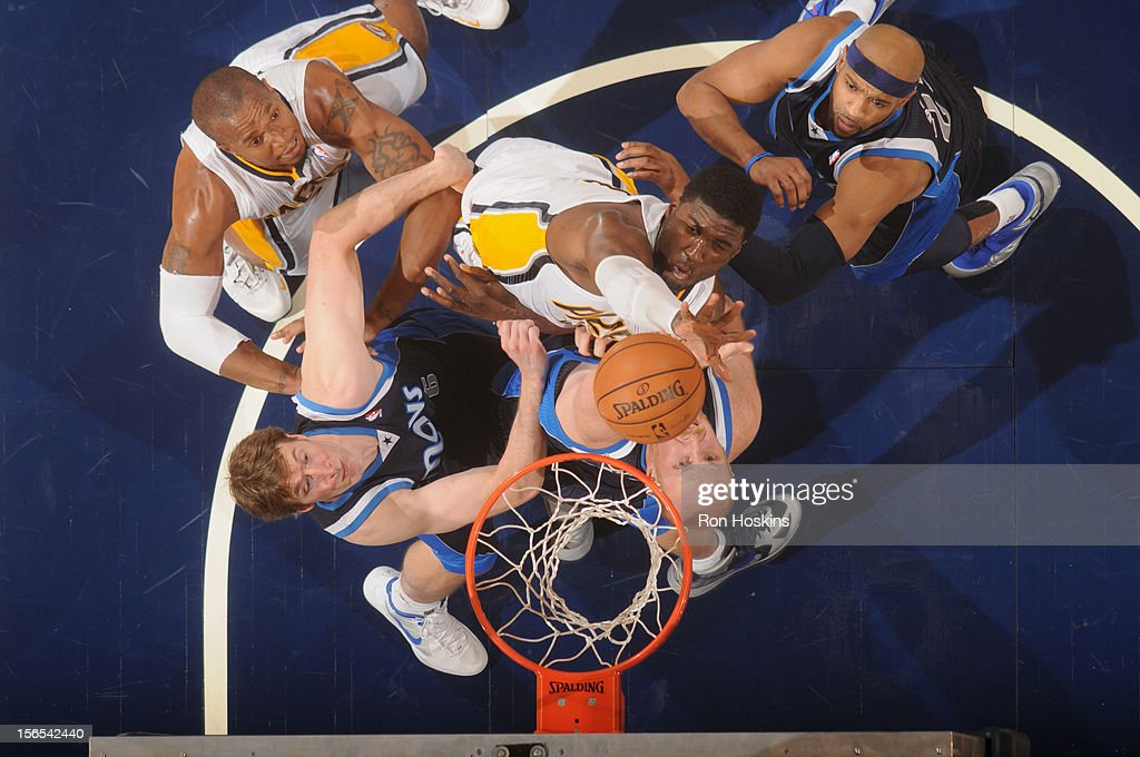 Paul George #24 of the Indiana Pacers fights for the rebound against <a gi-track='captionPersonalityLinkClicked' href=/galleries/search?phrase=Chris+Kaman&family=editorial&specificpeople=201661 ng-click='$event.stopPropagation()'>Chris Kaman</a> #35 and <a gi-track='captionPersonalityLinkClicked' href=/galleries/search?phrase=Troy+Murphy+-+Basketball+Player&family=editorial&specificpeople=201794 ng-click='$event.stopPropagation()'>Troy Murphy</a> #6 of the Dallas Mavericks on November 16, 2012 at Bankers Life Fieldhouse in Indianapolis, Indiana.