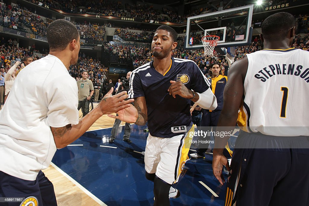 Paul George #24 of the Indiana Pacers gets introduced before the game against the Boston Celtics at Bankers Life Fieldhouse on December 22, 2013 in Indianapolis, Indiana.