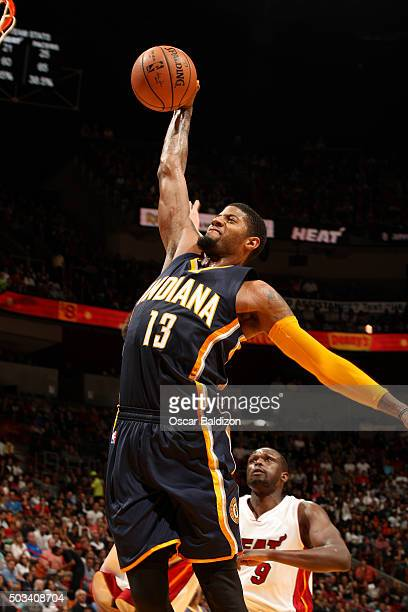 Paul George of the Indiana Pacers goes for the dunk during the game against the Miami Heat on January 4 2016 at American Airlines Arena in Miami...