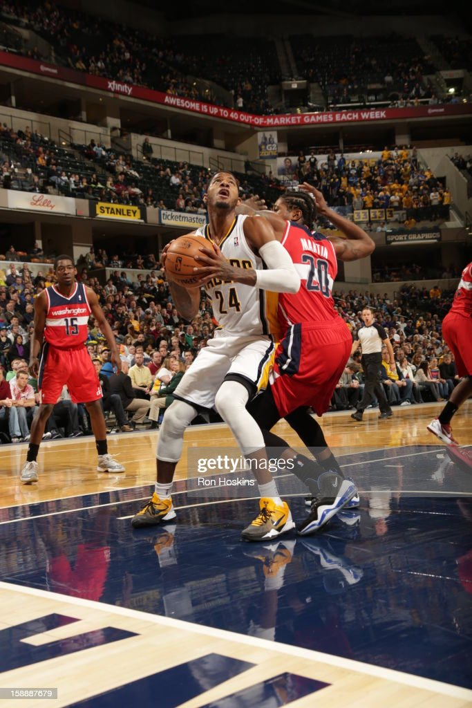 Paul George #24 of the Indiana Pacers goes to the basket against <a gi-track='captionPersonalityLinkClicked' href=/galleries/search?phrase=Cartier+Martin&family=editorial&specificpeople=834581 ng-click='$event.stopPropagation()'>Cartier Martin</a> #20 of the Washington Wizards on January 2, 2013 at Bankers Life Fieldhouse in Indianapolis, Indiana.